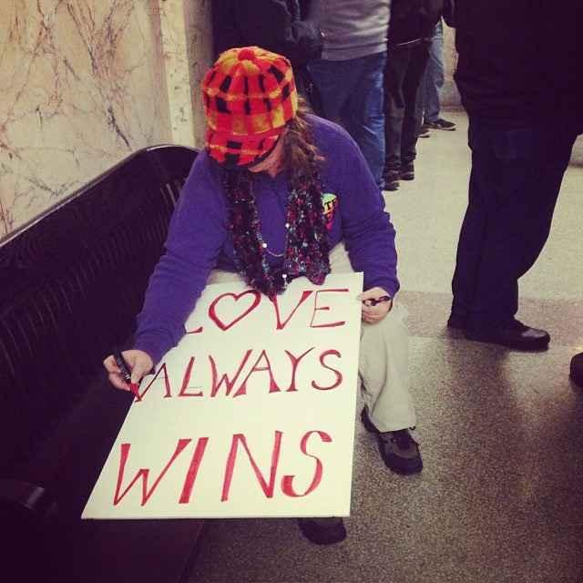 Love always wins sign