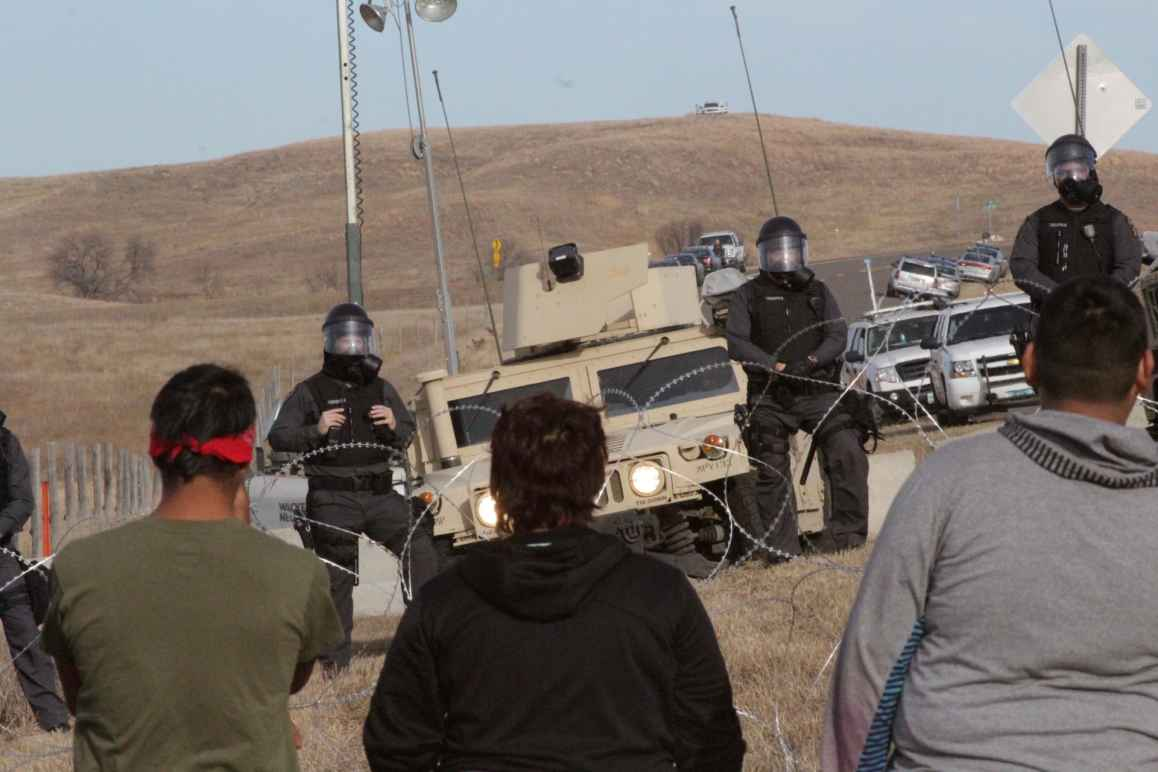Image of Police and Water Protectors at Standing Rock